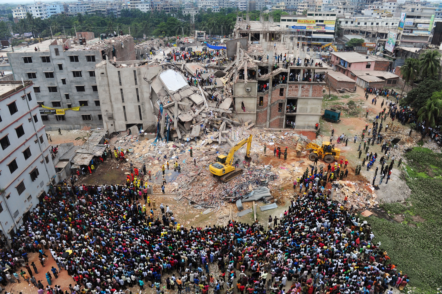 TOPSHOTS  Bangladeshi volunteers and rescue workers are pictured at the scene after an eight-storey building collapsed in Savar, on the outskirts of D...
