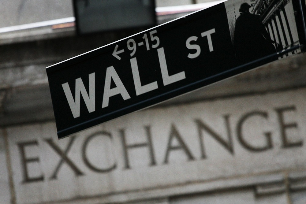 In this Sept. 30, 2008 file photo, a Wall St. sign hangs in front of the New York Stock Exchange.
