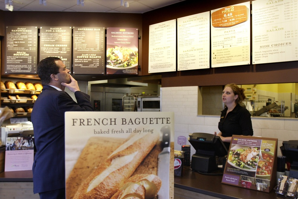 A customer reviews the sandwich board at the Panera store in Brookline, Mass. in this 2010 photo. Panera has withdrawn a pilot program that allowed cu...