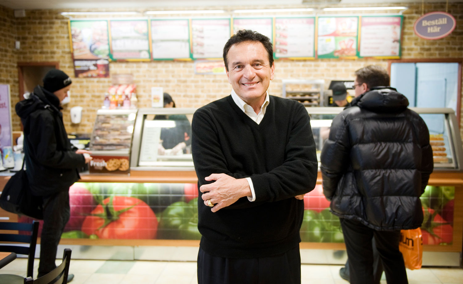 Fred DeLuca, President and founder of sandwich maker Subway, poses in a Subway restaurant at