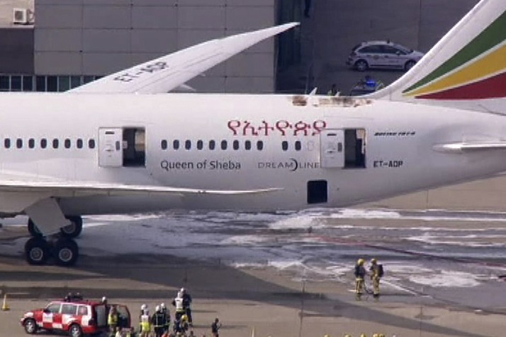 Emergency crew stands near the tail section of a Boeing 787 Dreamliner, operated by Ethiopian Airlines, which caught fire at Britain's Heathrow airpor...