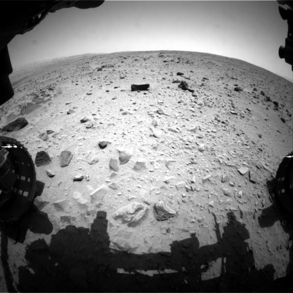NASA's Curiosity Mars rover captured this image with its left front Hazard-Avoidance Camera (Hazcam) just after completing a drive that took the mission's total driving distance past the 1 kilometer (0.62 mile) mark. Image released July 17, 2013.