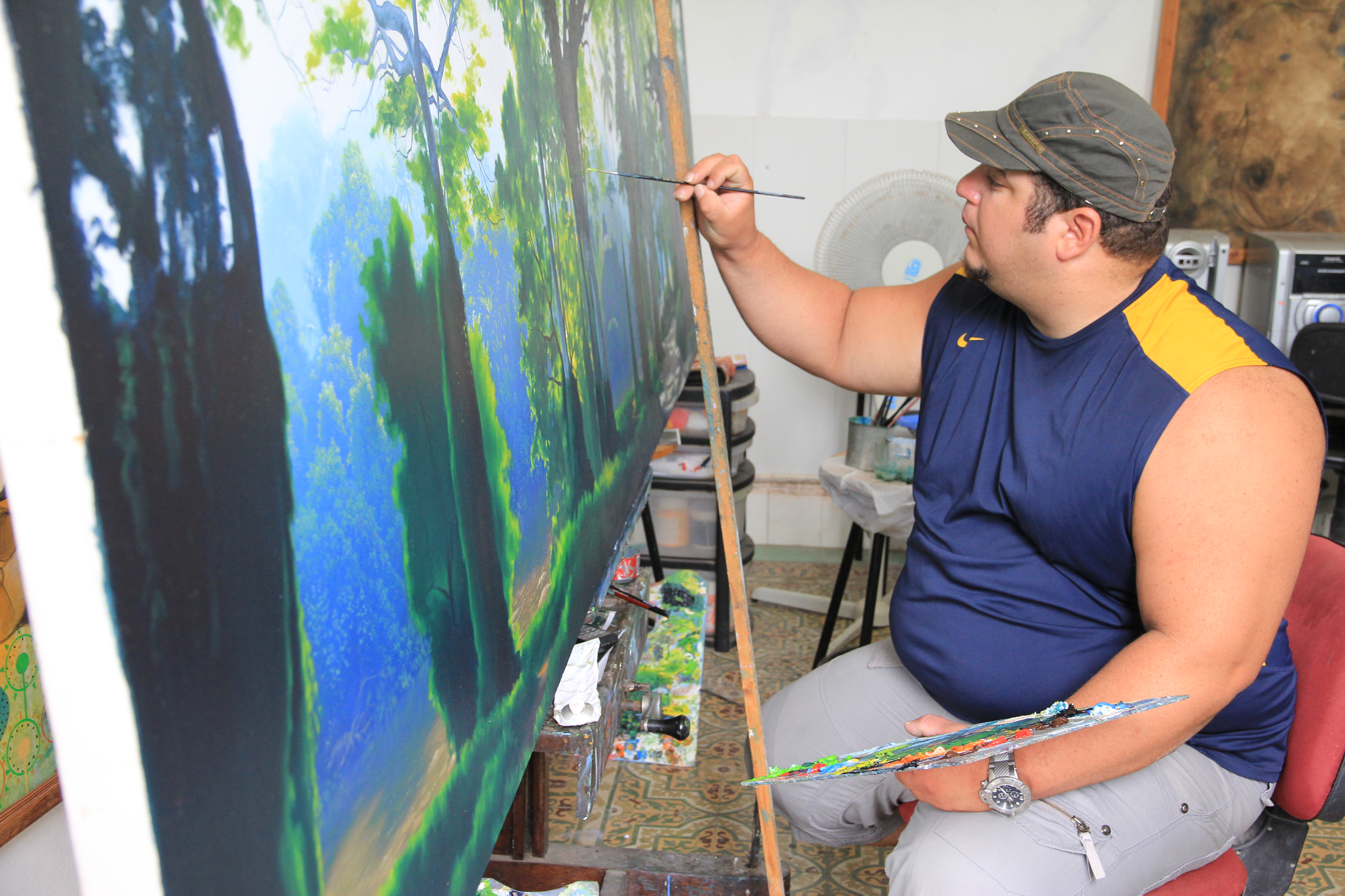 Cuban artist Dionel Delgado, pictured here, is one of Cuba's well-paid painters.