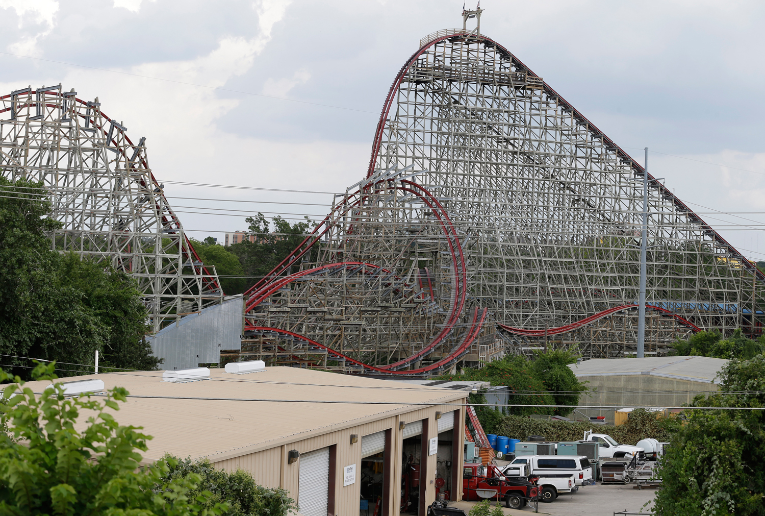 The Texas Giant roller coaster ride sits idle at the Six Flags Over Texas park Saturday, July 20, 2013, in Arlington, Texas. Investigators will try to...