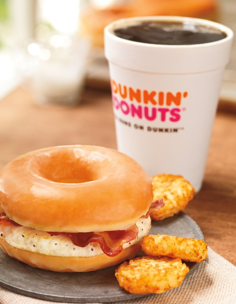 This photo provided by Dunkin' Brands, Inc., shows the company's glazed donut breakfast sandwich.