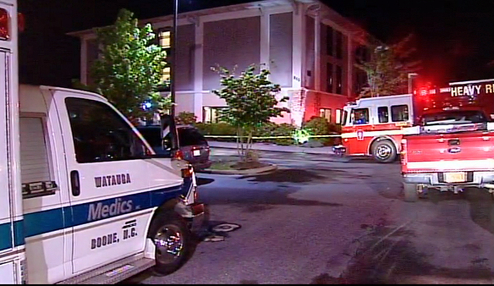 Emergency vehicles outside a hotel in Boone, N.C., where an 11-year-old-boy died from asphyxia.