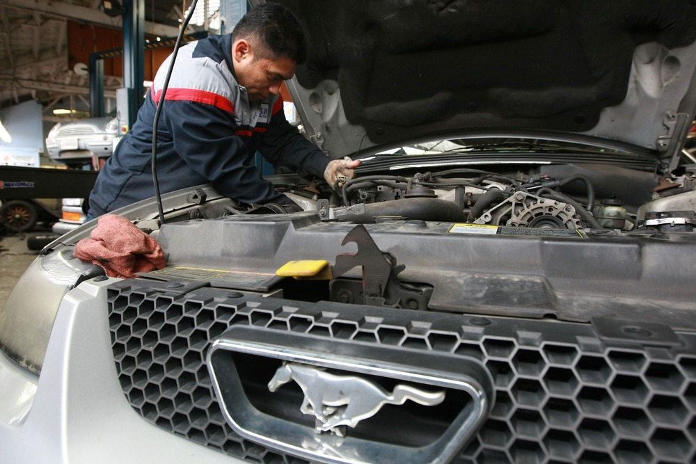 Mechanic Harrison Garcia works on a Ford Mustang at Brake and Wheel Service Center January 5, 2009 in San Francisco, Calif.