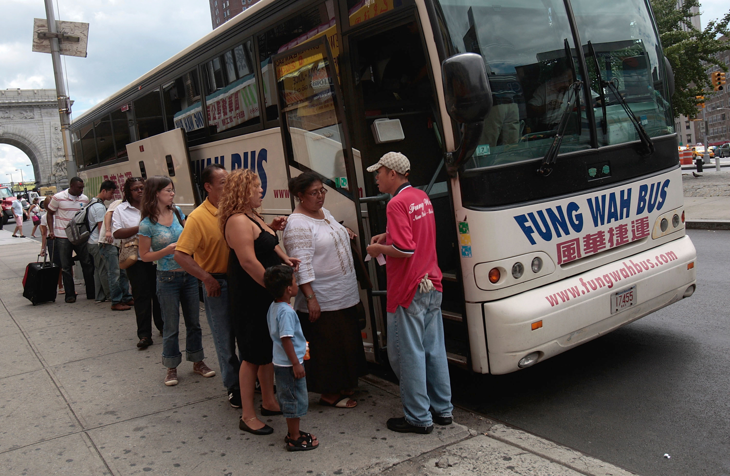 Passengers prepare to load a Fung Wah bus before leaving Manhattan for Boston.