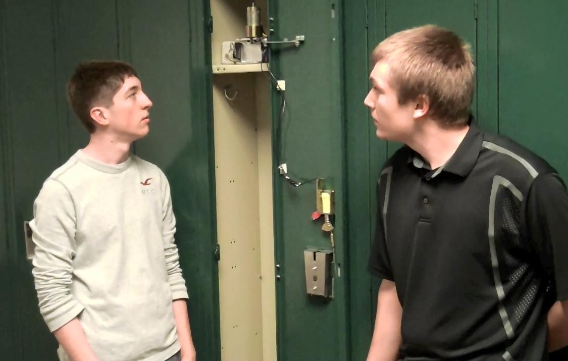 Students build robotic locker opener for disabled for Pinckney garage door