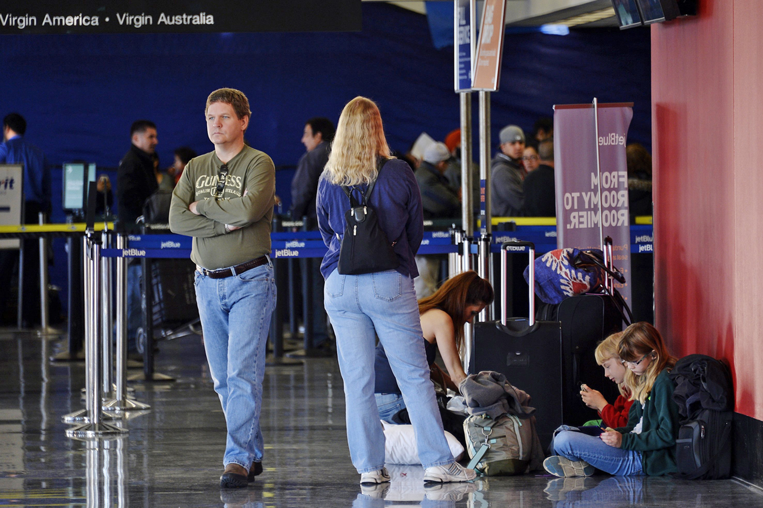 LOS ANGELES, CA - NOVEMBER 2: A family waits to travel a day after a shooting that killed one Transportation Security Administration worker and injure...