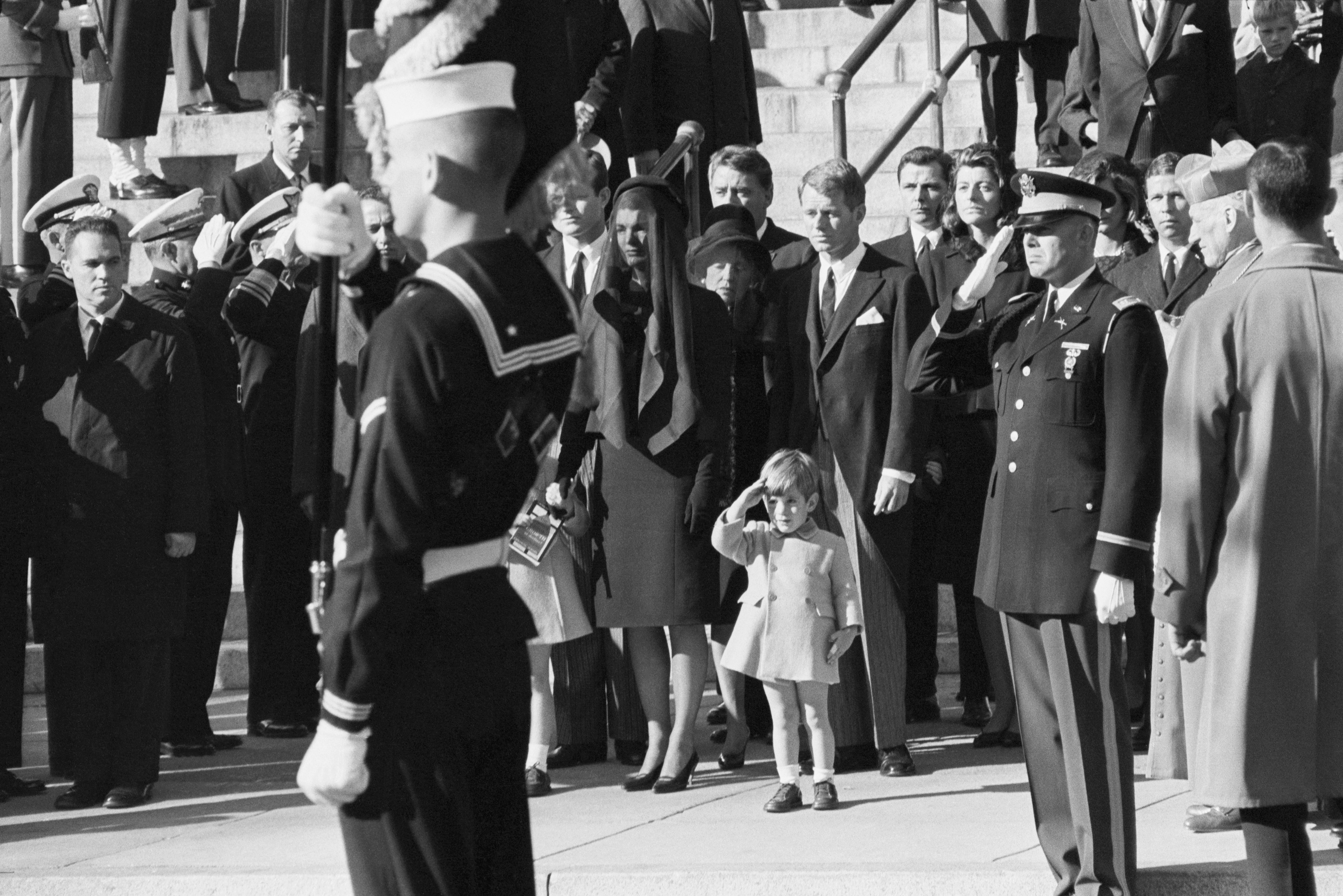 John F. Kennedy Jr., 3, salutes as the casket of his father, the late President John F. Kennedy, is carried from St. Matthew's Cathedral in Washington, D.C., on Nov. 25, 1963.