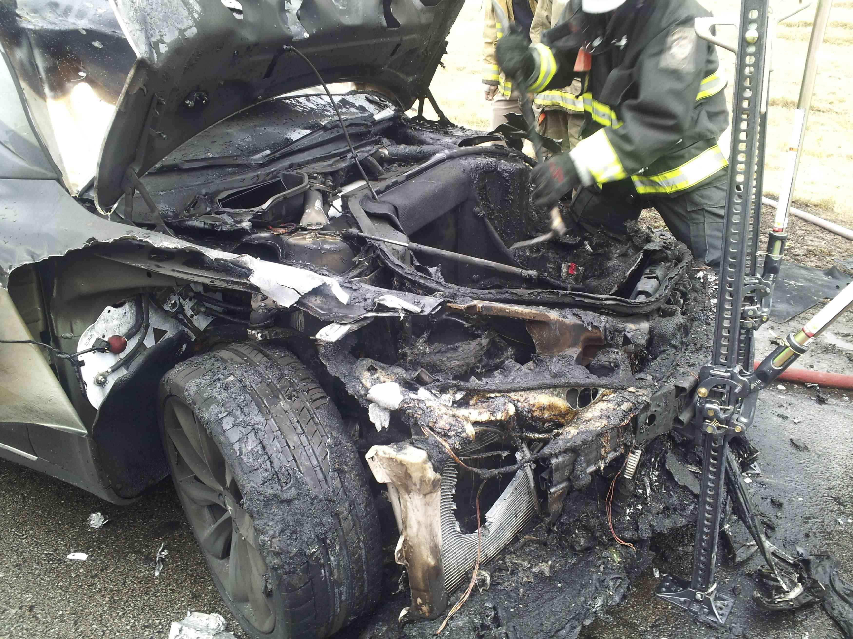 A Tesla Model S automobile destroyed by a fire is seen in a handout picture from the Tennessee Highway Patrol taken in Smyrna, Tenn., Nov. 6, 2013.