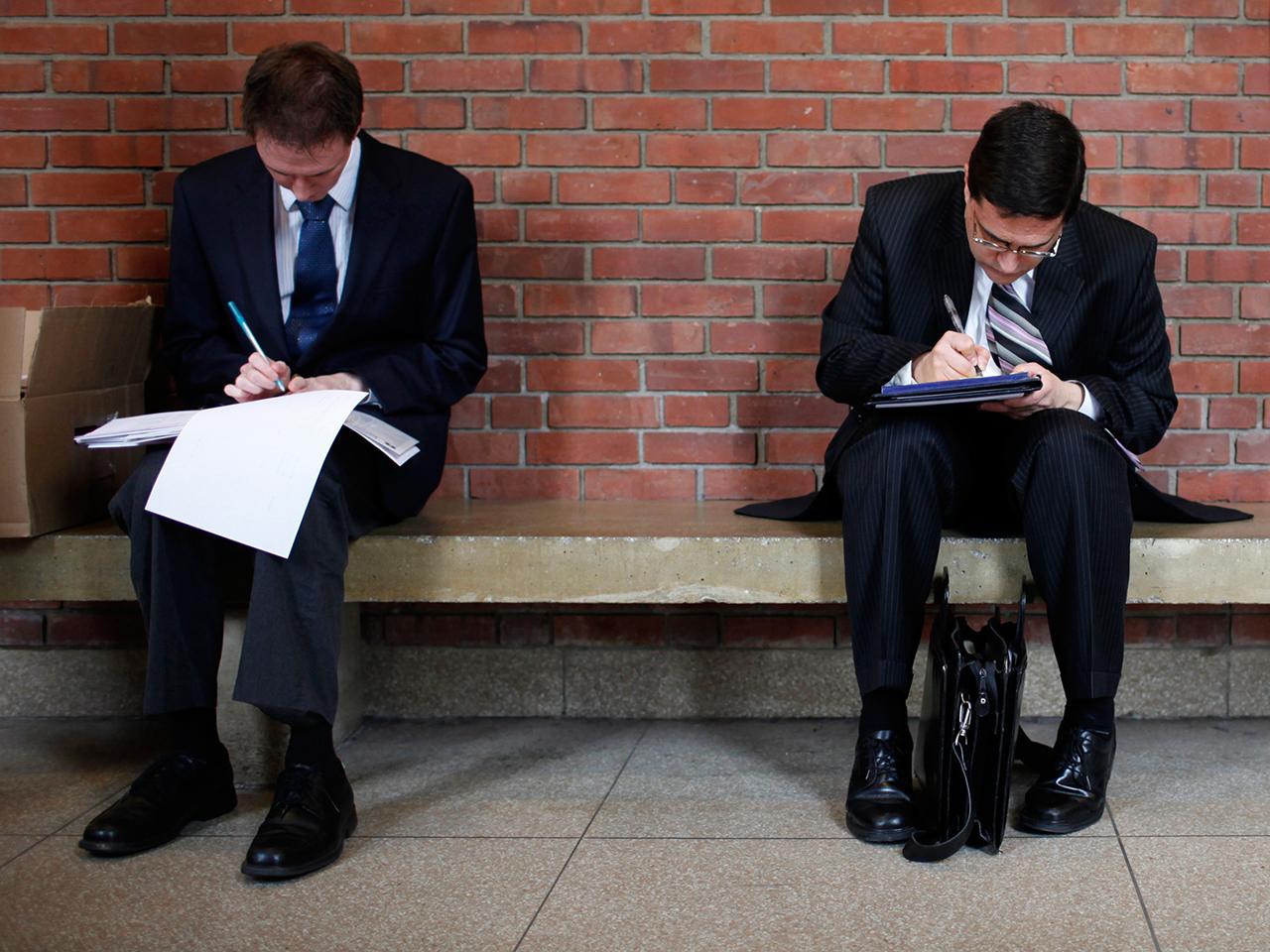 Job seekers prepare for a career fair.