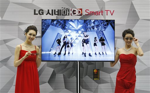 South Korean models pose with a CINEMA 3D Smart TV