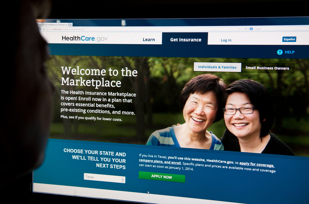 (FILES)A woman looks at the HealthCare.gov insurance exchange internet site in this October 1, 2013 file photo in Washington, DC.  With America's budg...