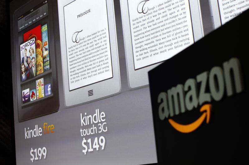 Graphics of the new Amazon Kindle tablets are seen at a news conference during the launch of Amazon's new tablets in New York, September 28, 2011. REU...