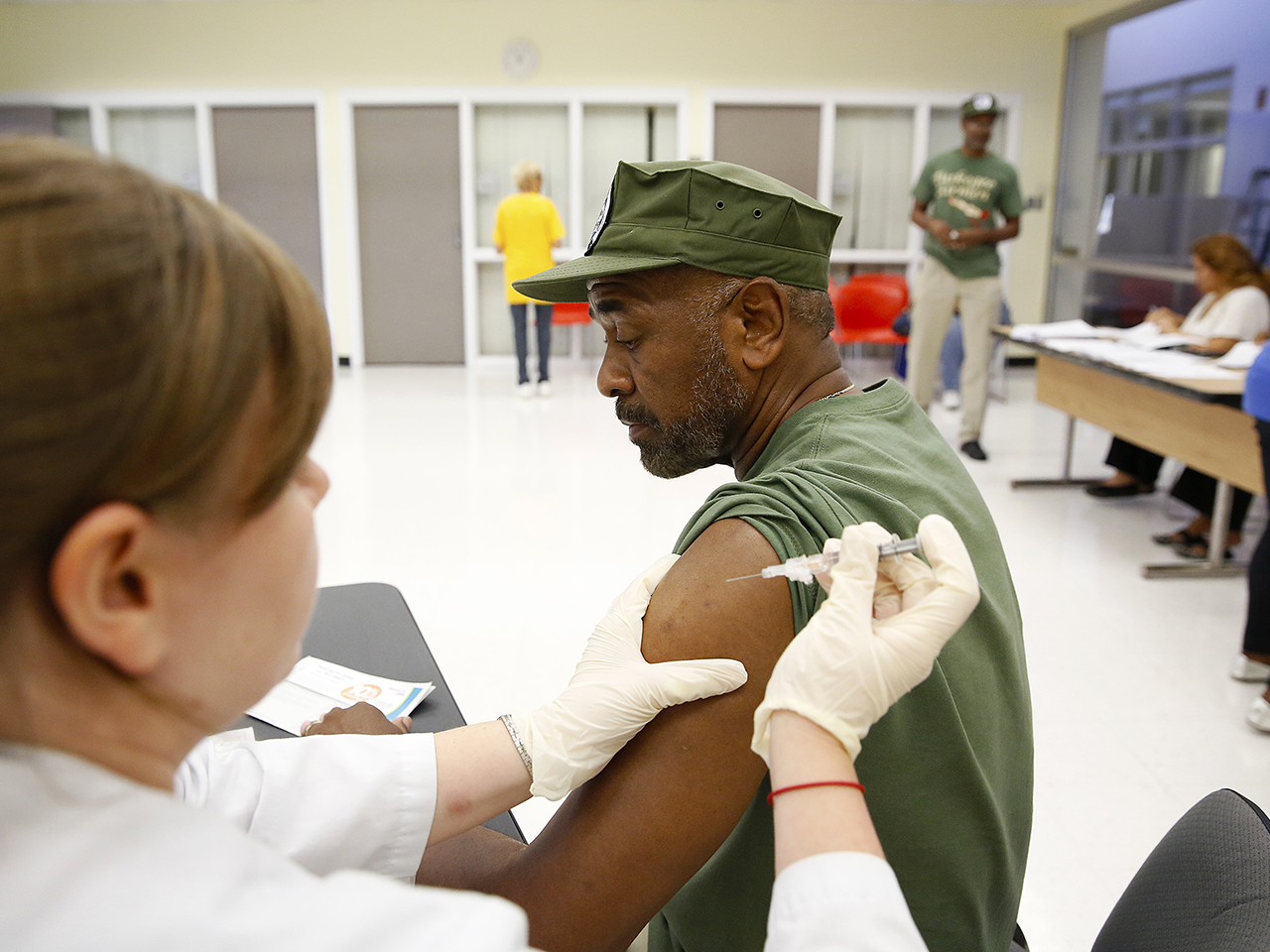 IMAGE DISTRIBUTED FOR NATIONAL COUNCIL ON AGING AND SANOFI PASTEUR - Joseph Robert receives his flu shot during the Falls and Flu Prevention Day at th...