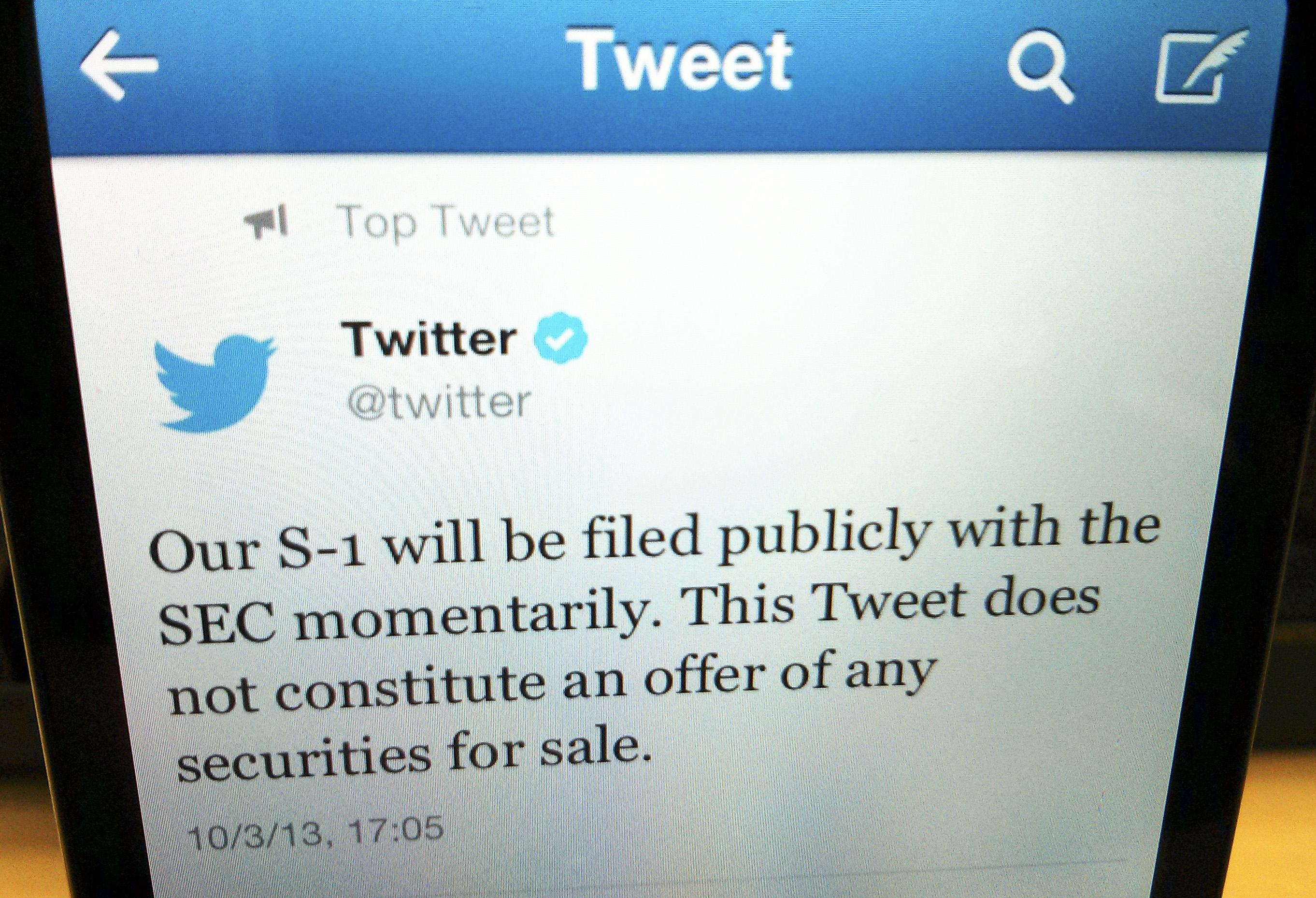 A tweet from Twitter Inc. announcing its IPO filing is shown in this photo illustration.