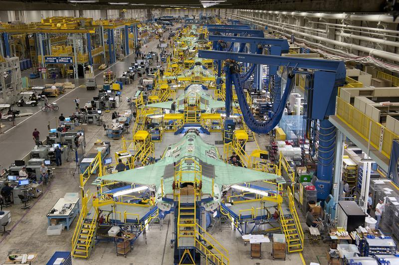 Workers can be seen on the moving line and forward fuselage assembly areas for the F-35 Joint Strike Fighter at Lockheed Martin Corp.'s factory in Fort Worth, Texas, in this Oct. 13, 2011, photo.  Lockheed said it will furlough 3,000 workers on Monday because of the government shutdown.