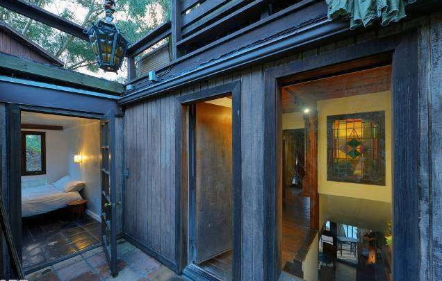 The two-bedroom home has multiple decks in a treehouse-like setting.