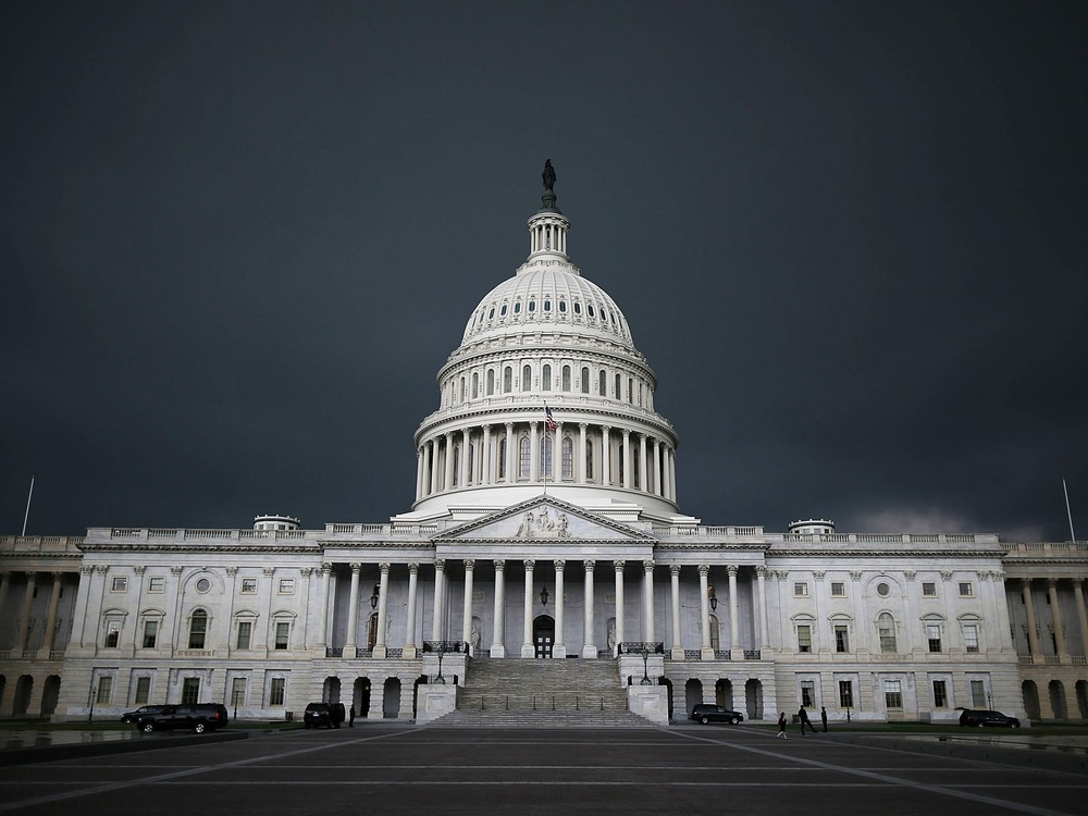 WASHINGTON, DC - JUNE 13:  Storm clouds fill the sky over the U.S. Capitol Building, June 13, 2013 in Washington, DC. Potentially damaging storms are ...