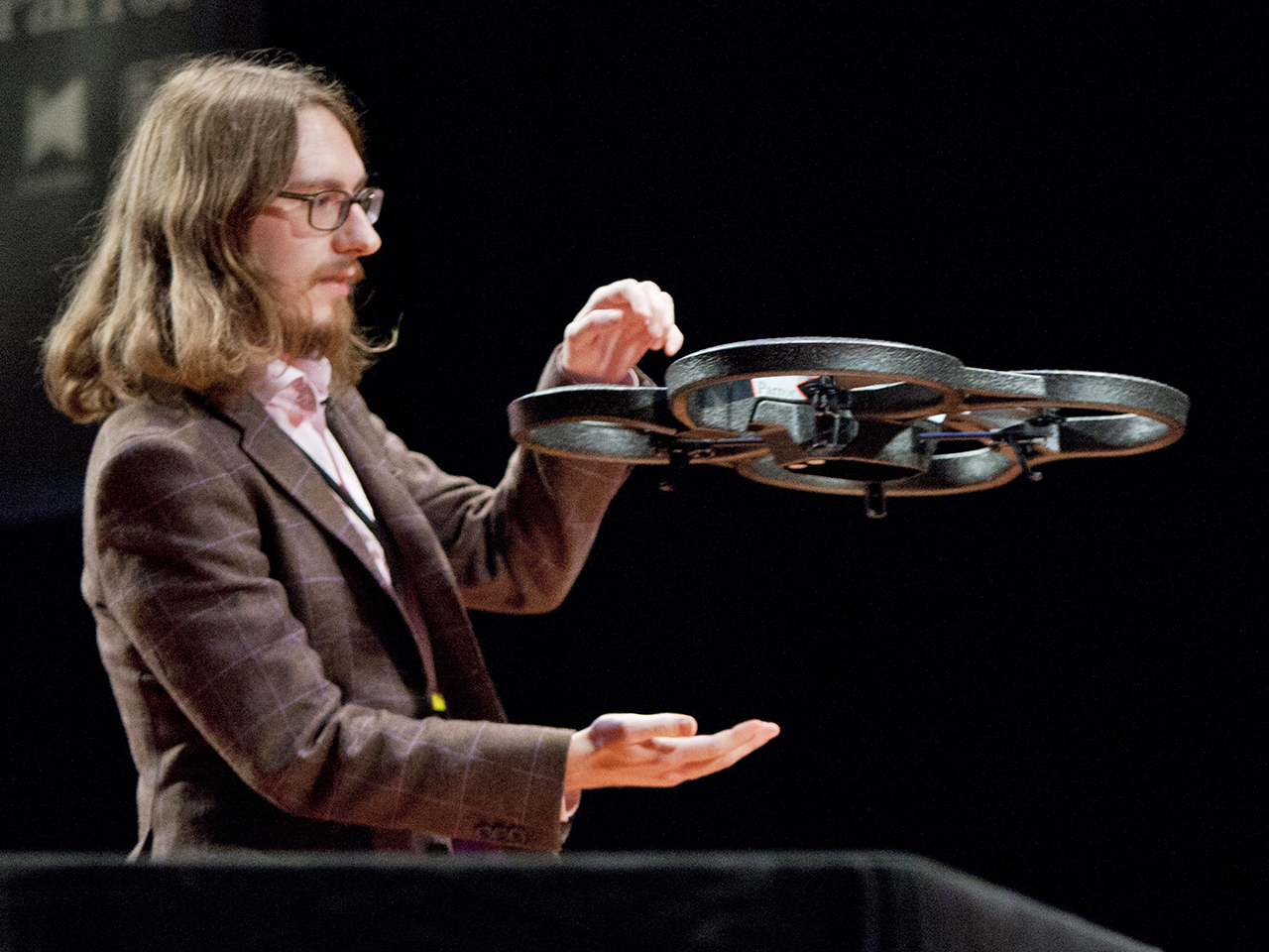 (10/11/2013) Julian Szajdzicki catches an AR Parrot 2.0 drone during a demonstration by Nodecopter at the DARC conference's AfterDARC session in NYU's...