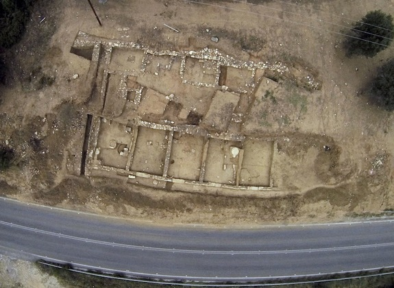 During excavations in the summer of 2013, archaeologists uncovered the portico of the ancient city of Argilos, which sits along the northern coast of the Aegean Sea in modern-day Greece. This aerial view shows the ruins that were excavated, including five of the seven storerooms that make up the portico.