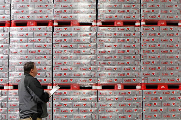 Warehouse manager Chad Sadler inventories cases of Diet Coke, waiting to be delivered to stores, in a warehouse at the Swire Coca-Cola facility in Draper, Utah, in this 2011 file photo. Sales volume of Diet Coke fell faster last year than regular Coke.