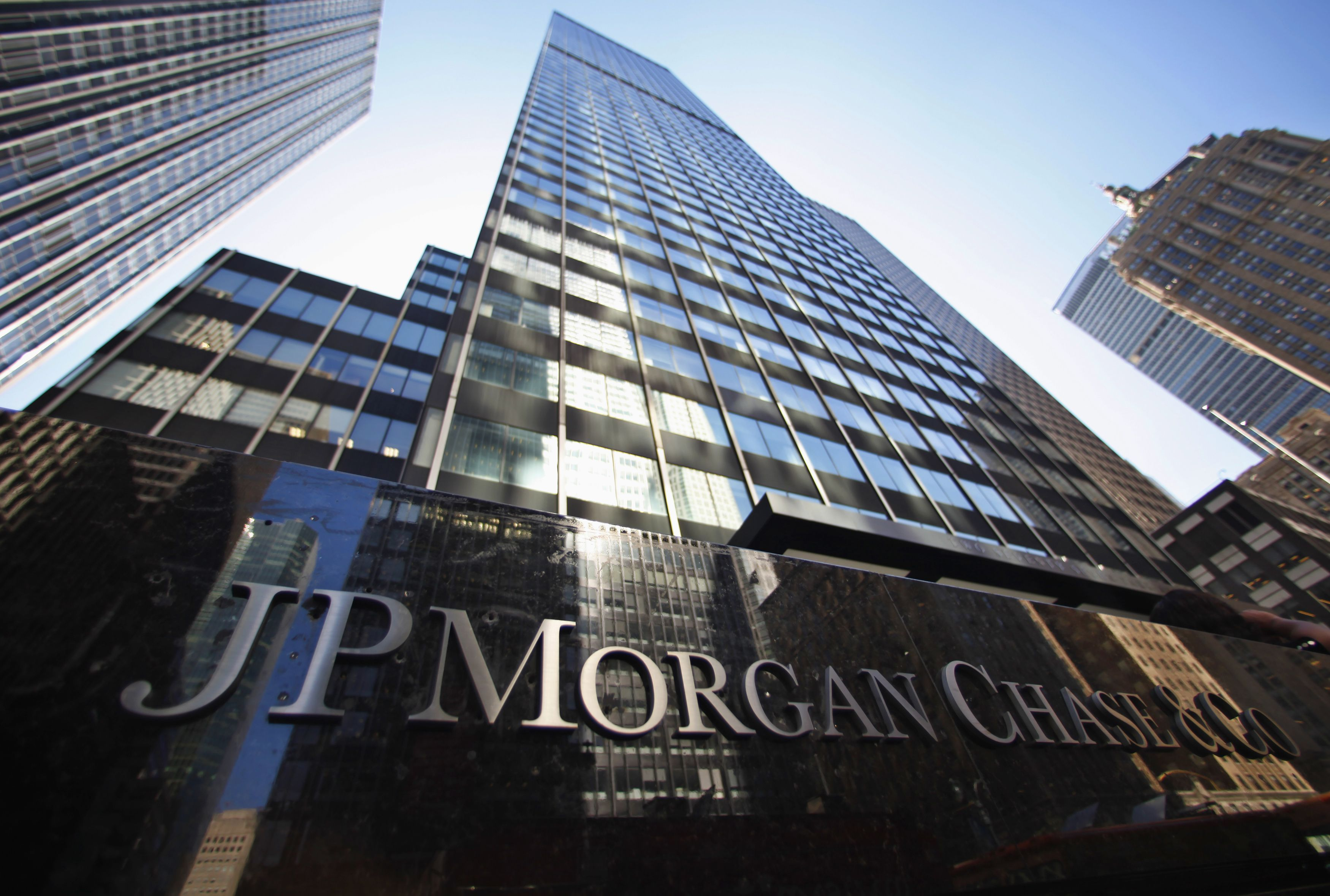 JPMorgan Chase has reportedly reached an agreement with regulators to pay $100 million to settle charges over a trading scandal.