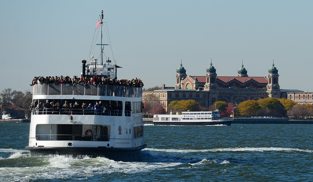 A ferry carrying visitors makes its way to Ellis Island, the island that ushered millions of immigrants into the United States, as it reopens Monday to visitors the first time since Superstorm Sandy.