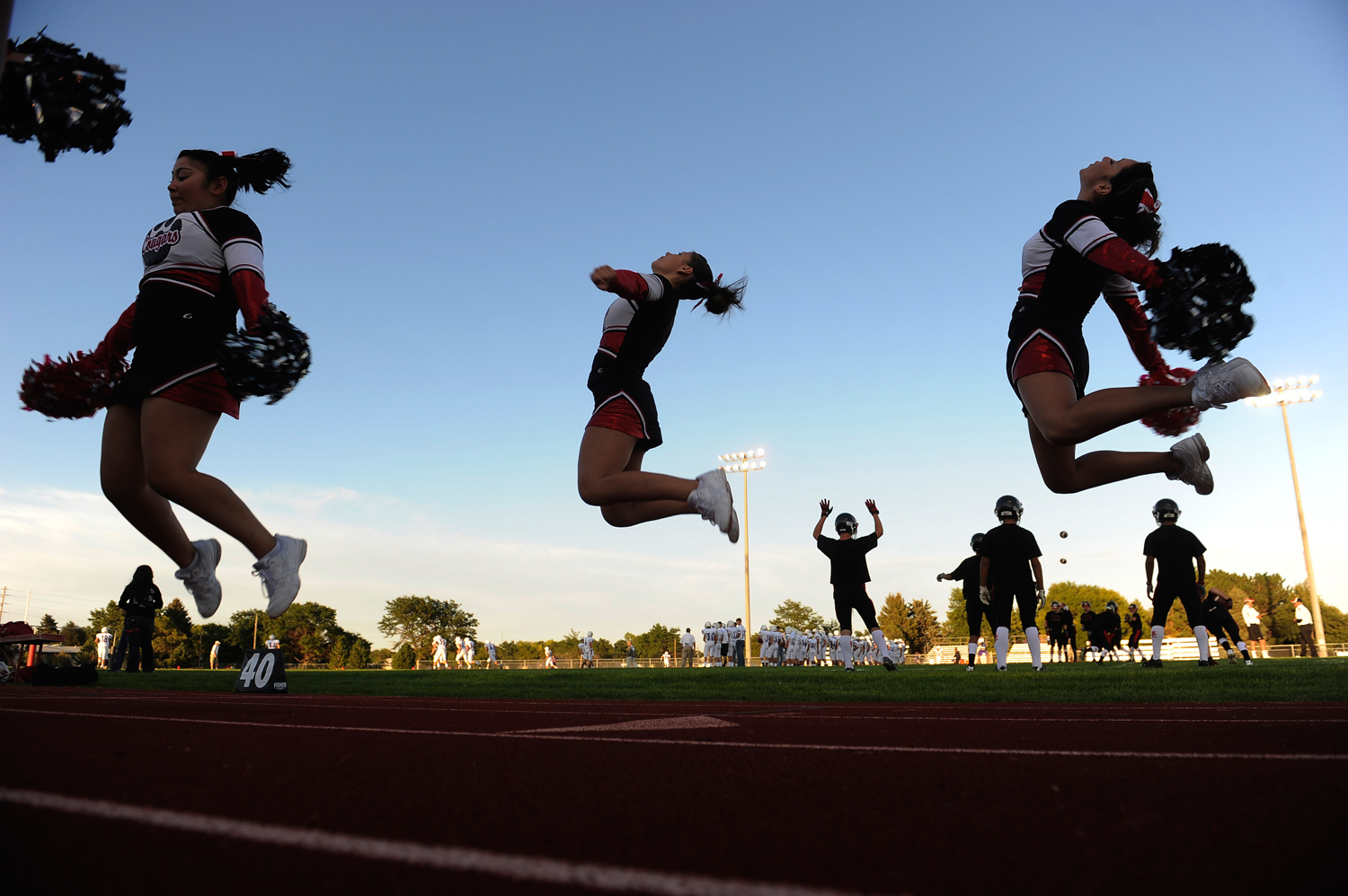 Burlington varsity cheerleaders warmed up before the game Friday.  The Burlington High School football team hosted Wray Friday night, September 9, 201...