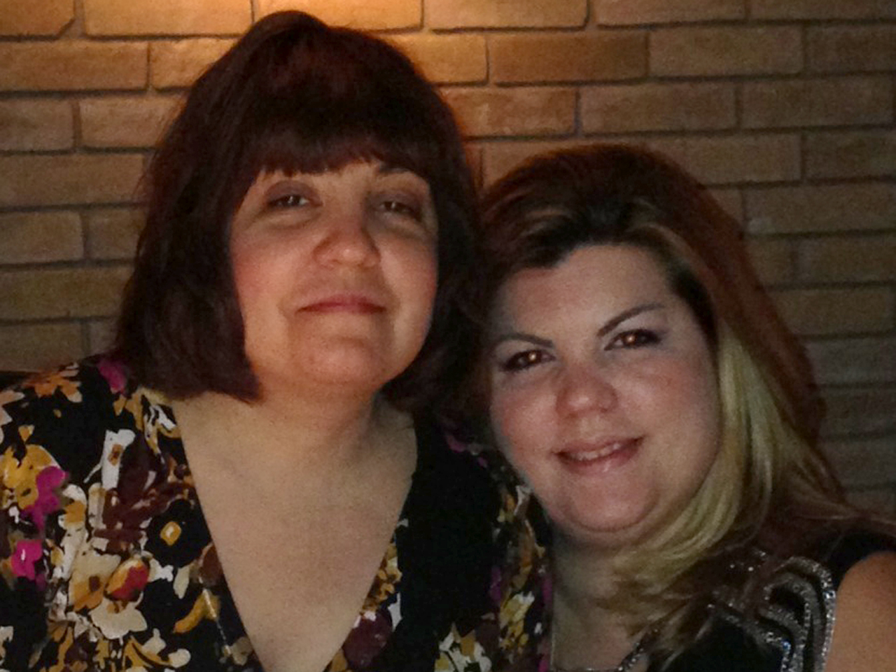 Katherine Perez, 37, right, was diagnosed with breast cancer in March. Her sister, Gina Garcia, 44, was diagnosed with the disease this summer. Both s...