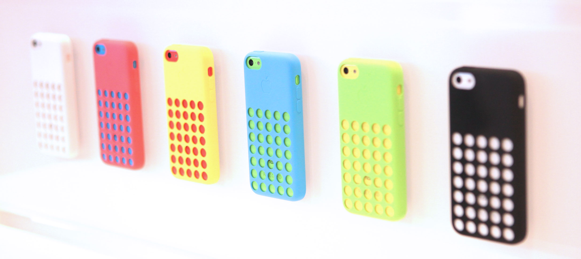 iPhone 5C cases, shown on display at the Apple iPhone launch event in Cupertino, Calif.