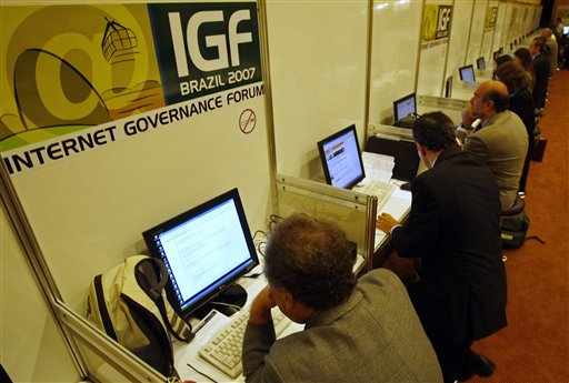 FILE - In this Nov. 12, 2007 file photo, people uses the internet during the Internet Governance Forum in Rio de Janeiro, Brazil. President Dilma Rous...