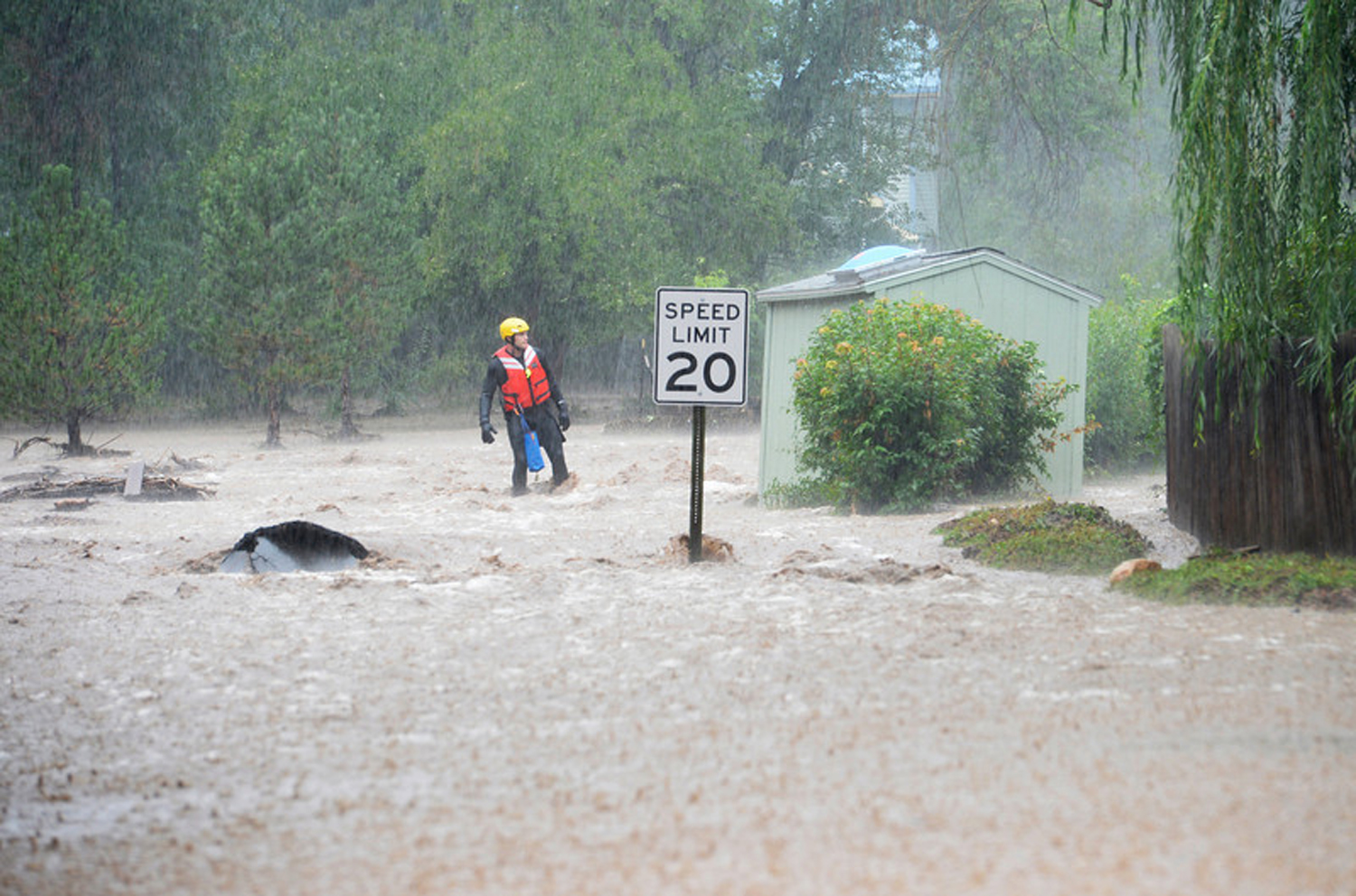 A rescue worker in Boulder rains