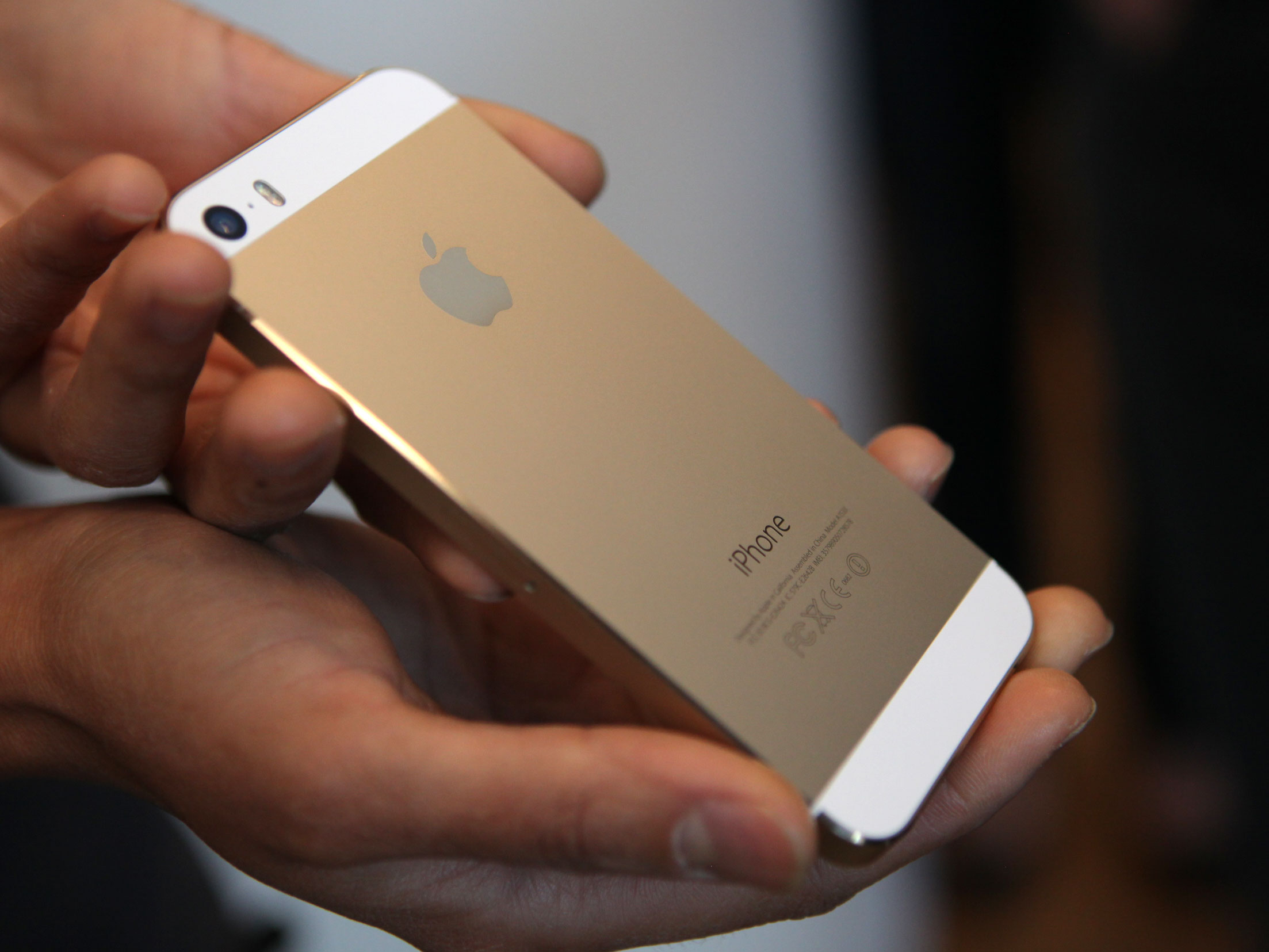 Gold iPhone being shown off at Apple's unveiling in Cupertino, Calif. on Sept. 10.