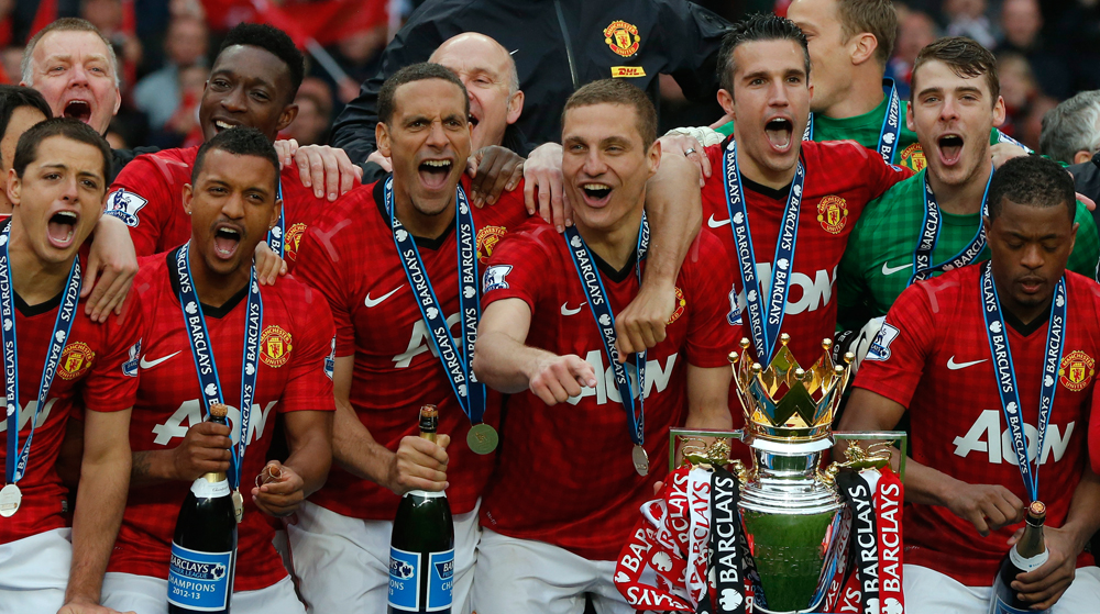 Manchester United players celebrate with the English Premier League trophy at Old Trafford stadium in Manchester, northern England May 12, 2013. Alex ...