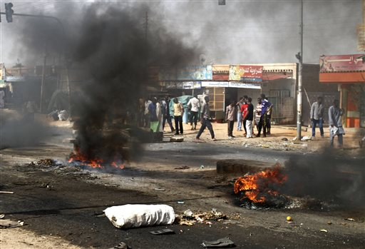 Protesters burn tires and close the highway to northern cities amid a wave of unrest over the lifting of fuel subsidies by the Sudanese government, in...