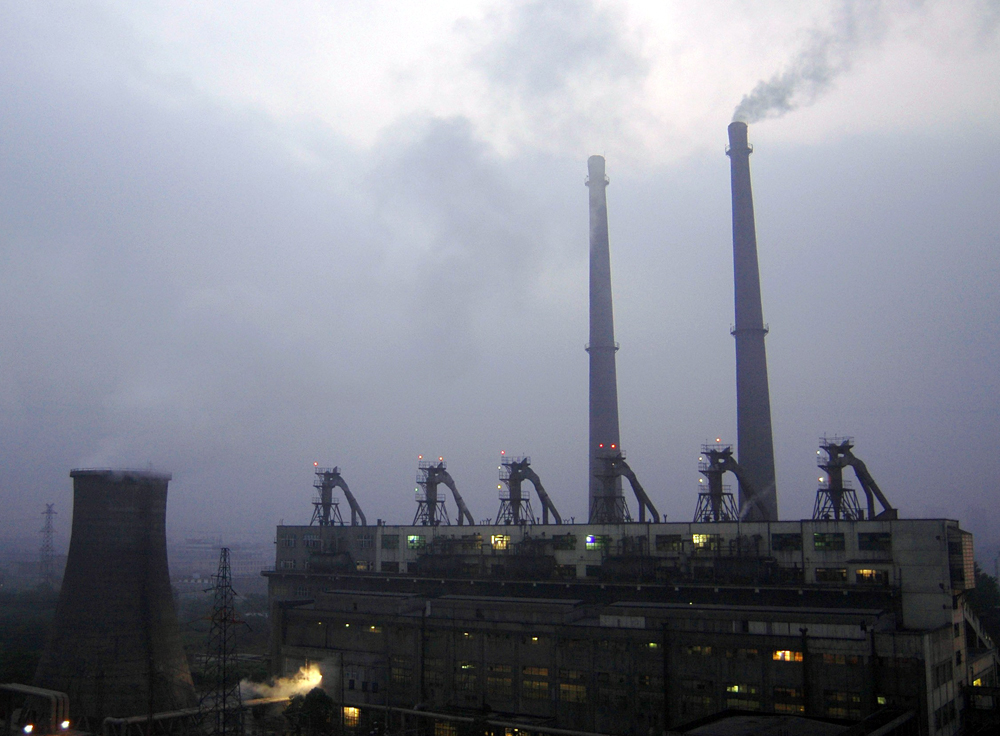 A view of a coal-burning power plant during daybreak in Xiangfan, central China's Hubei province, June 25, 2006. China has a key role to play in the d...