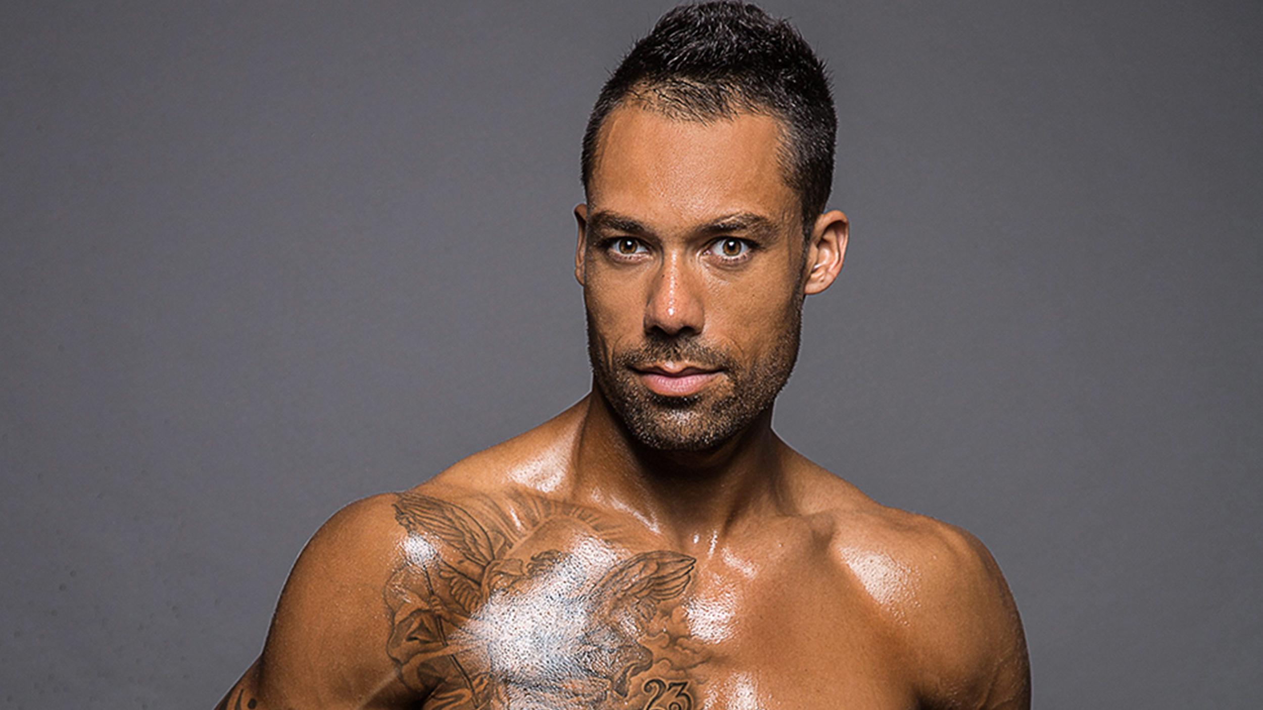 Male model Blake Beckford poses shirtless with ileostomy