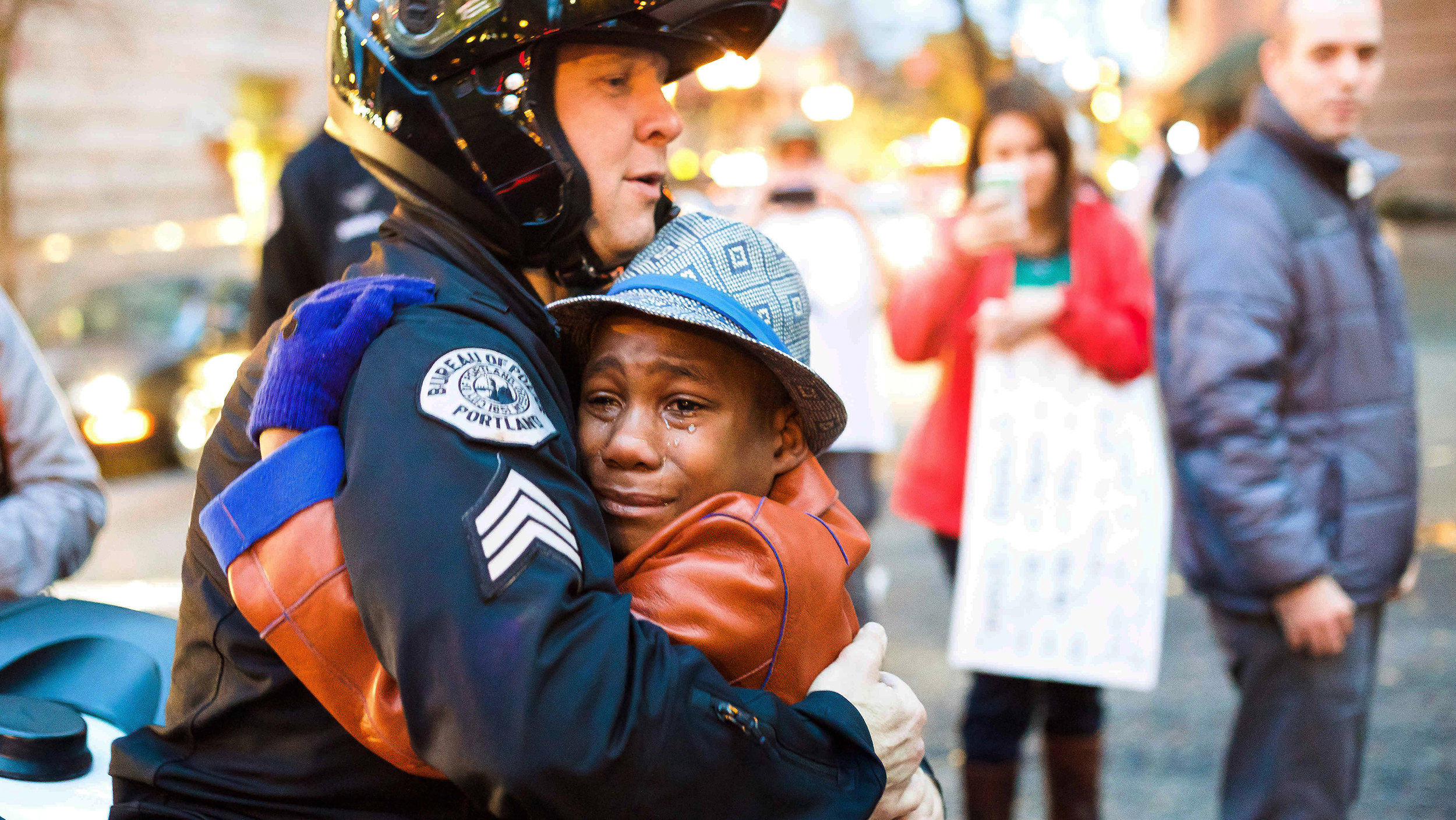 6 things you don t know about that iconic ferguson hug photo