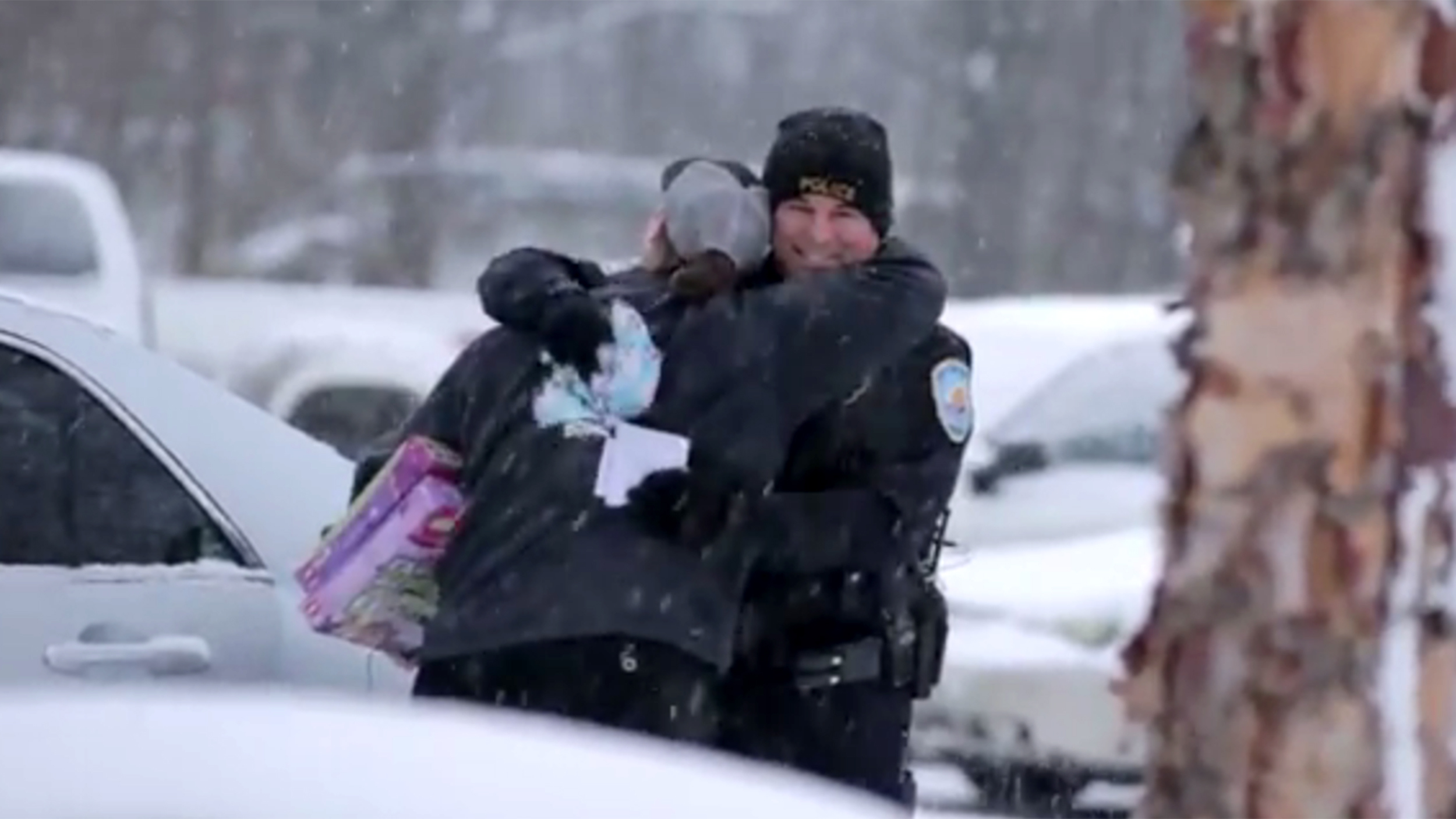 Viral video shows cops pulling over drivers to give them holiday gifts & Surprise! Video shows cops stopping drivers to give them holiday gifts