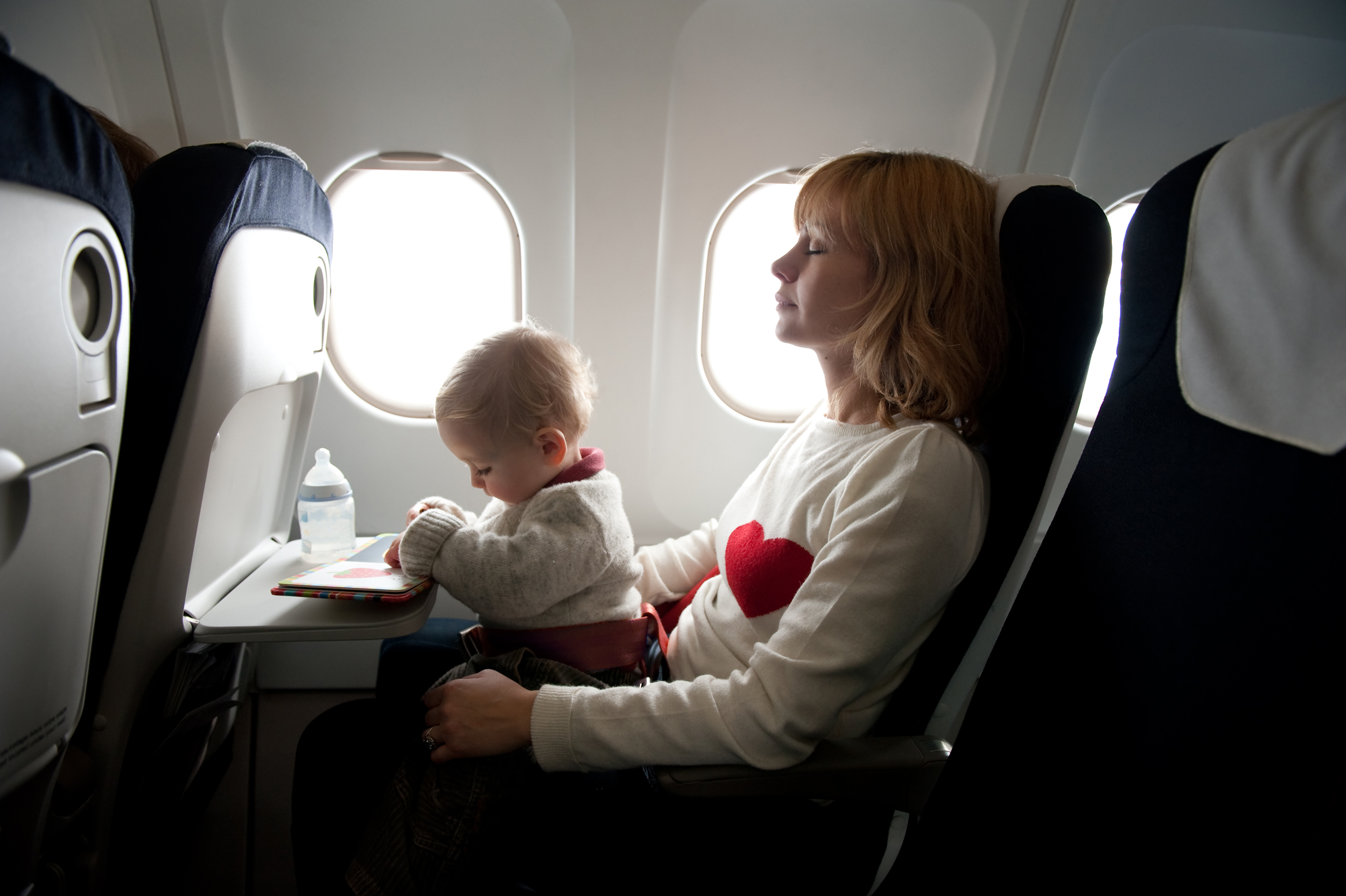 baby and mother on airplane