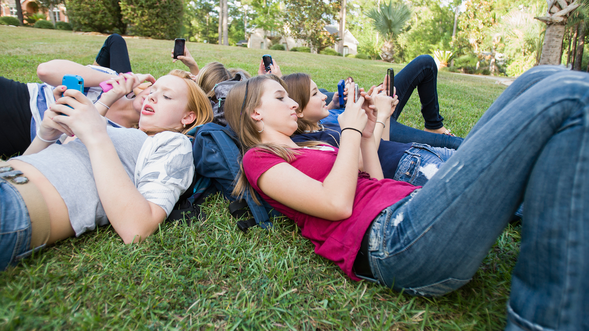 teen, teens, text, hang out, grass, outside, chidlren, school, kids, texting