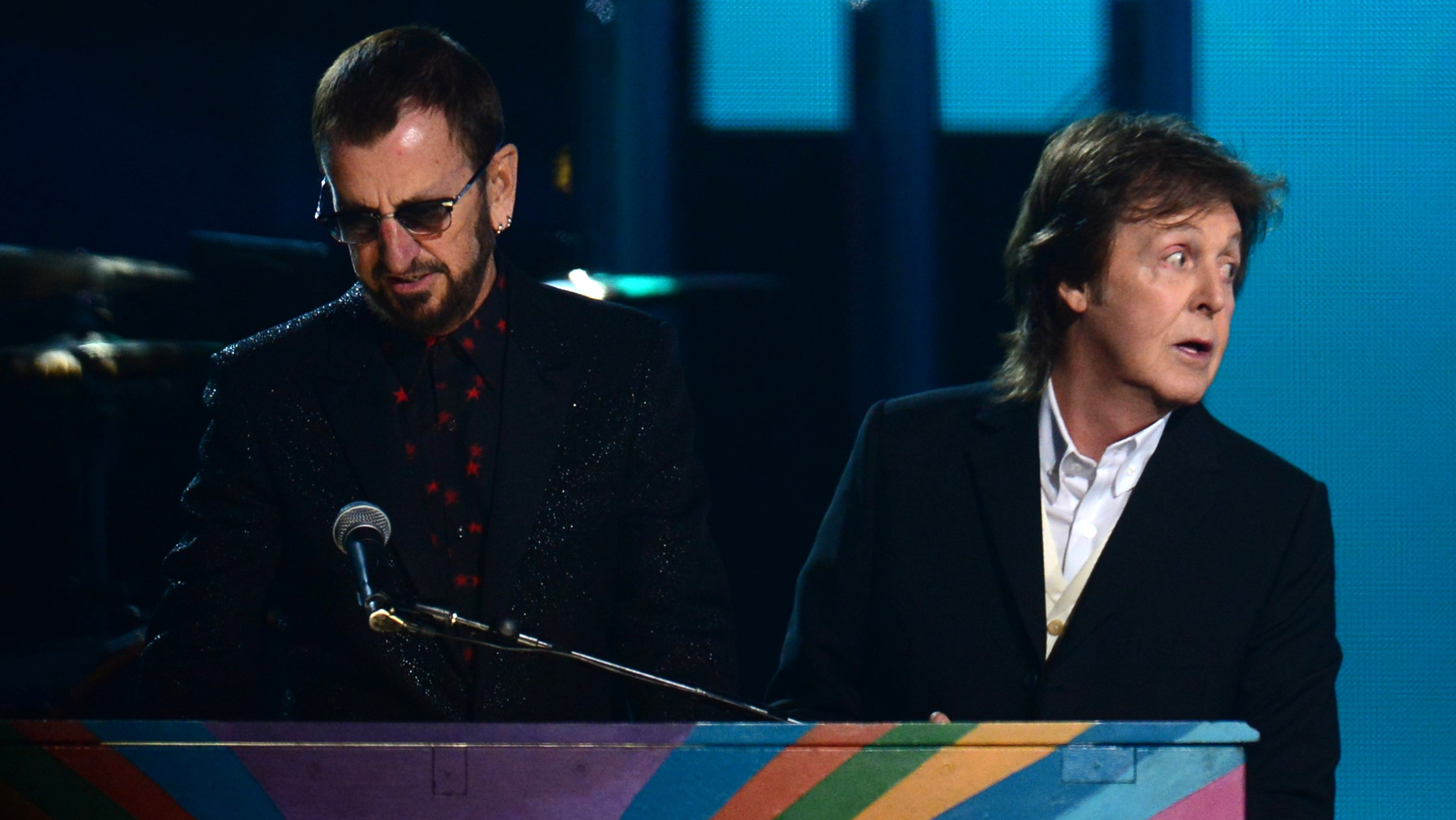 Former Beatles members Paul McCartney (R) and Ringo Star perform on stage during the 56th Grammy Awards at the Staples Center in Los Angeles, Californ...
