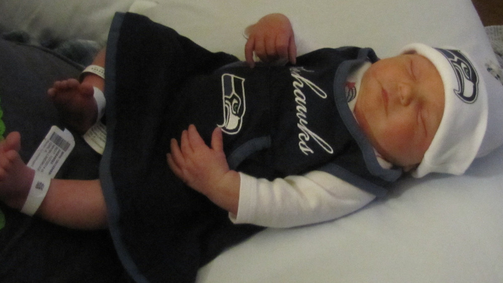 new products 3bfd8 0793a Seattle Seahawks fans name baby '12th Mann'
