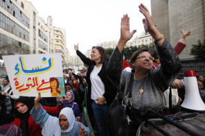 Image: Women shout slogans against Egyptian President Mohamed Mursi and members of the Muslim Brotherhood during a protest rally in Cairo