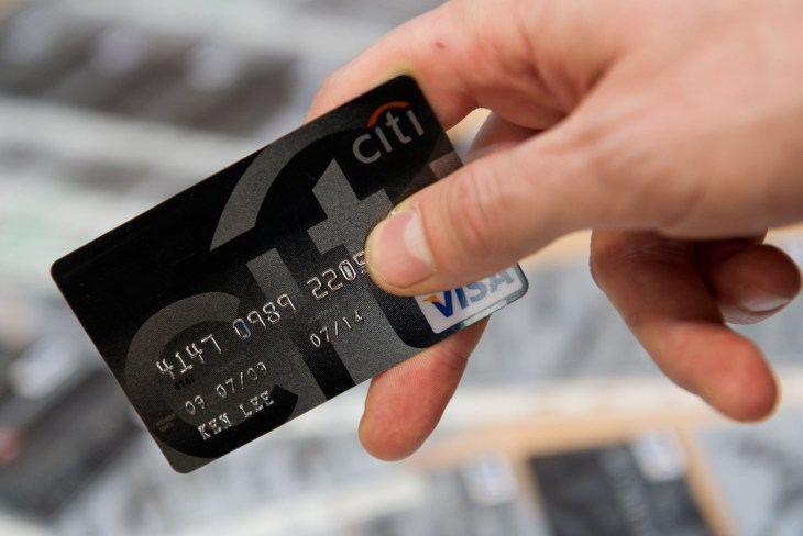 A police officer holds a confiscated counterfeit credit card in Hamburg, Germany, 08 April 2013. Four people are suspected of the counterfeiting man...