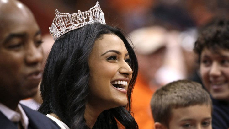 Miss America 2014 Nina Davuluri attends the NCAA college basketball game Syracuse and North Carolina State in Syracuse, N.Y., Saturday, Feb. 15, 2014....