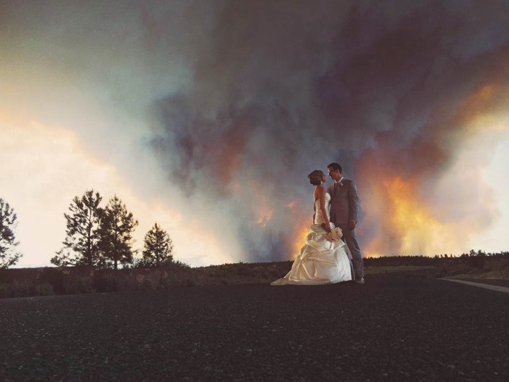 Photographer Josh Newtoncaptured these images of April Hartley and Michael Wolber with a blazing wildfire as their backdrop.